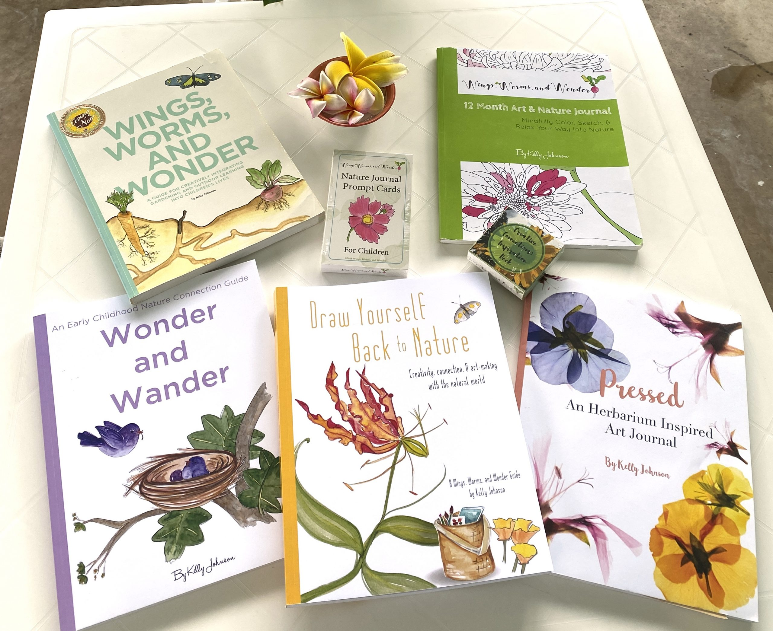 The family of Wings, Worms, and Wonder creative nature connection guide books!